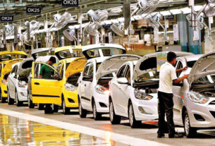 Line of Cars Arranged In An Automobile Sector.