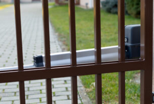 Shiny Brown coloured Automatic gate with Gate opener installed perfectly to enhance security